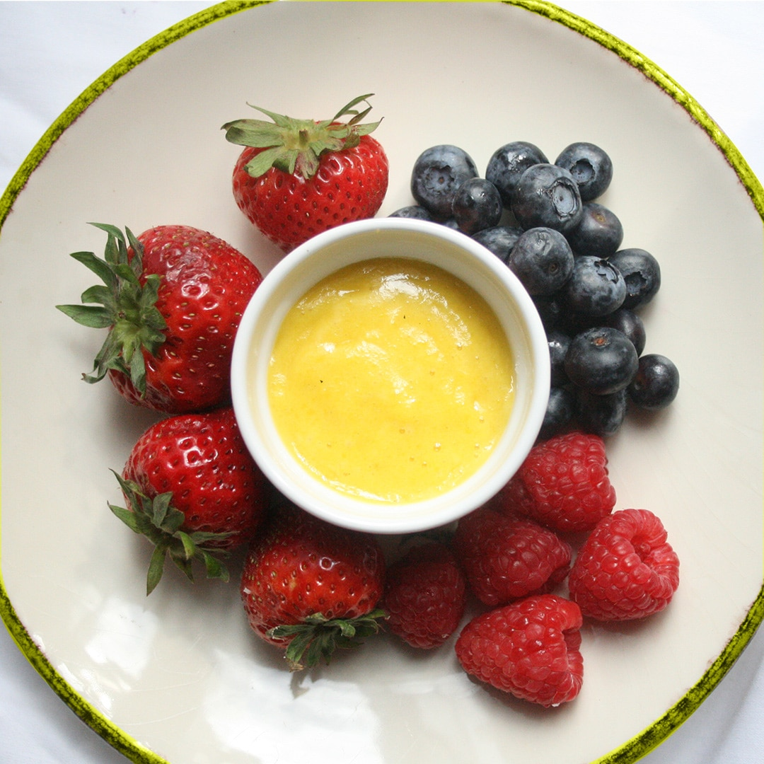 Fruit Custard on a plate with berries